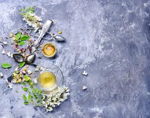Fototapete - Tea with acacia flavor