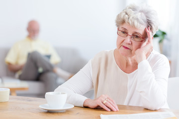 Sad elderly woman thinking about divorce with husband