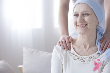 Happy elderly woman with cancer