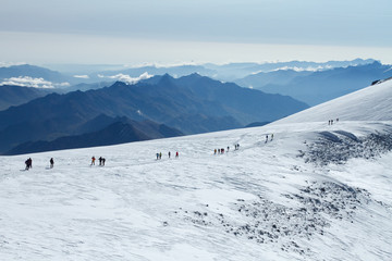 People go to the top of Mount Elbrus
