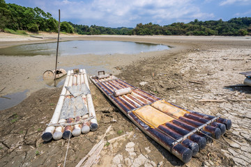 Lake of Dreams, a small but beautiful fishing port located in Wushantou Reservoir, Guantian, Tainan, Taiwan is drying up with cracks and bamboo boats are left aside.