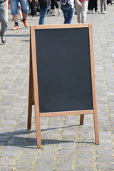 blank blackboard chalkboard advertising a-frame sign or customer stopper in pedestrian street