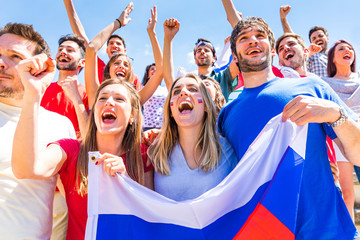 Russian supporters celebrating at stadium with flags