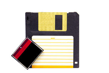 Concept of the revolution of data storage from floppy disk to compact flash card.  Object isolated on white background.