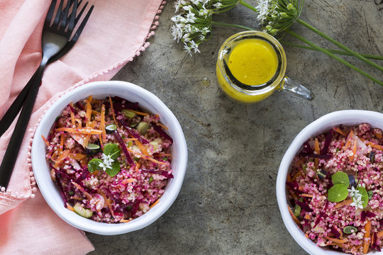 Pink and red Millet Salad in bowls with a pink napkin