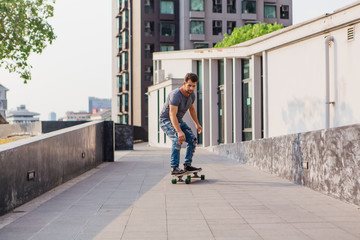 Young man riding a skateboard on the street.