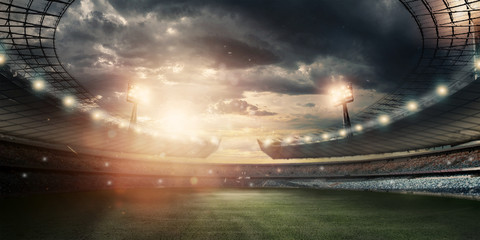 Stadium in the lights and flashes, football field. Concept sports background, football, night stadium. Mixed media, copy space.