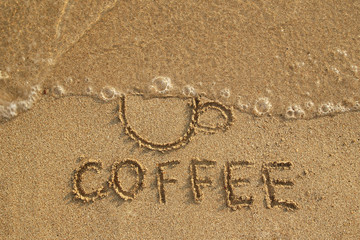 Drawing a cup washed away by a wave and inscription Coffee on the wet sand, top view. Healthy lifestyle concept. Stop drinking coffee.