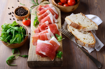 Photo sur cadre textile Assortiment Tray with raw ham, italian prosciutto crudo