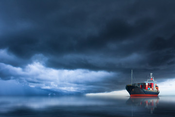 cargo container ship sailing in the ocean with storm sky .