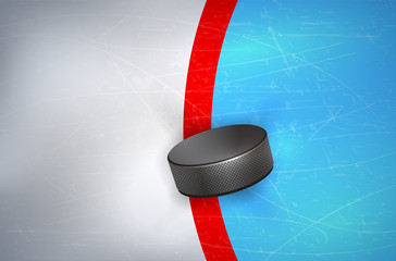 Hockey puck on ice - on red line of goalpost
