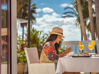 Young woman having breakfast outdoors