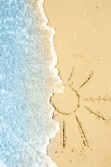 beautiful drawings inscription on the sand of the sea in the summer on the nature