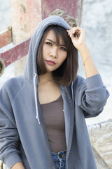 Portrait of Asian woman with hood