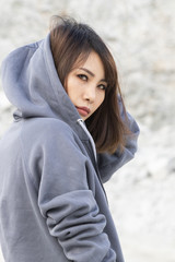 Back view young asian women with grey hood