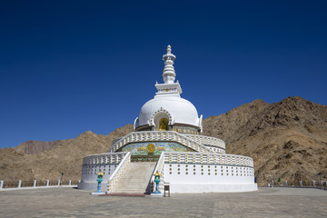 View of Tall Shanti stupa with blue sky, the big stupa in Leh and one from the best buddhist stupas in Jammu and Kashmir, Ladakh, India. White stupa in the Himalayan mountains