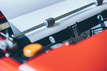 Blank paper sheet inserted into typewriter