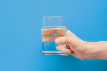 Drinking water concept one hand holding glass