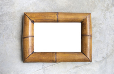 White background on bamboo wood picture frame on grey cement wall