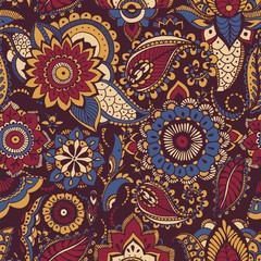 Colorful Persian paisley seamless pattern with buta motif and oriental floral mehndi elements on dark background. Motley vector illustration for textile print, wallpaper, wrapping paper, backdrop.