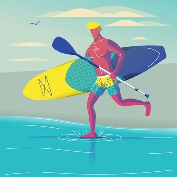 Guy running with surfboard