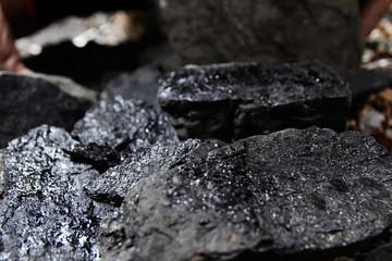 Close up of black coal pile. Coal mining