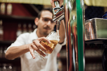 waiter pulling a beer in a pub