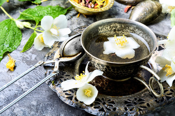 Fototapete - Green tea with jasmine