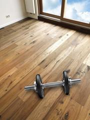 Dumbbels on Wooden Floor Boards