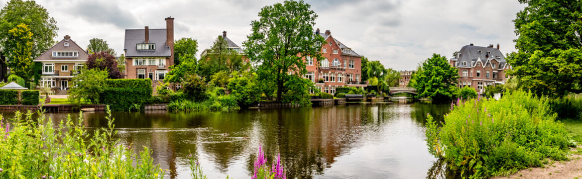 old mansion with little bridge, amsterdam on a river panorama