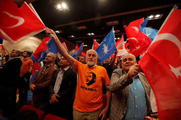 Supporters of the Turkish President, Tayyip Erdogan, shout slogans and wave flags as he arrives at a meeting to present his ruling AK Party's lawmaker candidates for the city of Istanbul