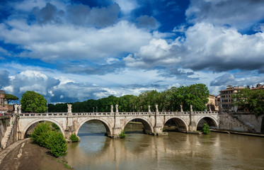 Ponte Sant'Angelo (Holy Angel Bridge) and River Tiber in Rome with spring beautiful clouds