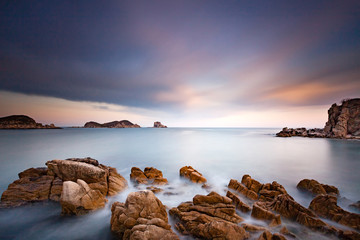 Beautiful landscape photo of amazing bay with sea rocks, sky clouds and soft water