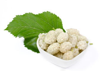 Fresh white mulberry in a heart shaped bowl with leaf