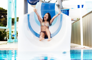girl rolls on water slides
