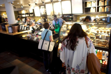 Patrons order from a Center City Starbucks, before more than 8,000 store nationwide will close this afternoon for anti-bias training, in Philadelphia, Pennsylvania