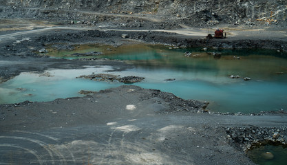 Copper or other rock mining area with ponds in Asia