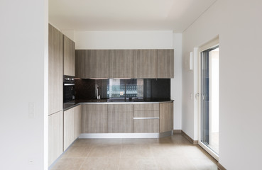 Interiors of modern apartment with white walls, kitchen
