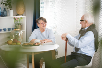 Elderly woman talking with grandfather