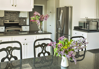 Kitchen interior. Bouquet of lilac on kitchen table