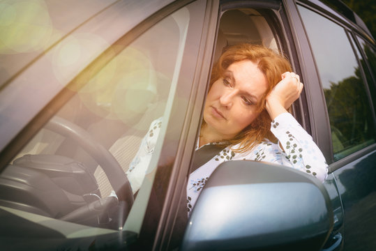 Bored woman in the traffic jam