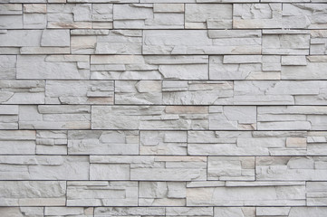Modern brick wall, slab stone pattern as background.