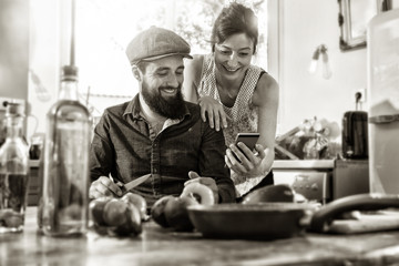 couple sharing a good time while preparing lunch in the kitchen