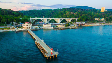 Drone view of pier of Matsesta marine station an the background of the Matsesta viaduct in summer day, Sochi, Russia