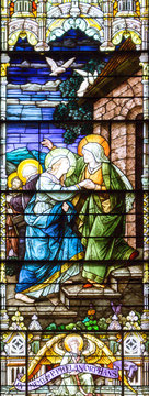 Salt Lake City,Utah,US. 31/08/2017. Stained glass in The Cathedral of the Madeleine depicting the visitation of Virgin Mary to Elizabeth.