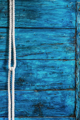 White rope on wooden deep blue board background vertical