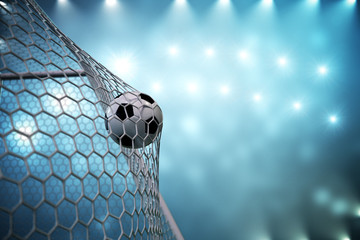 Fototapeta 3d rendering soccer ball in goal. Soccer ball in net with spotlight and stadium light background, Success concept. Soccer ball on blue background.