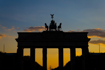 Silhouette of the Brandenburg gate (Brandenburger Tor) with sunset sky background