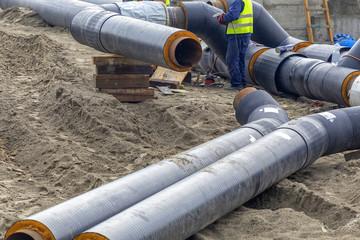 Metal worker grinding steel pipe 2