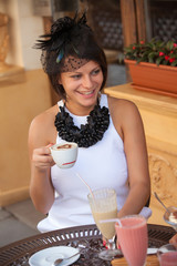 woman in a cafe with a mug of cappuccino